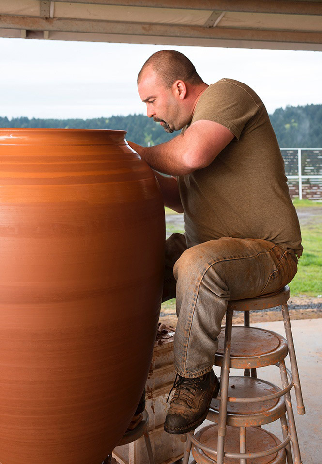 Andrew Beckham makes an amphora for wine