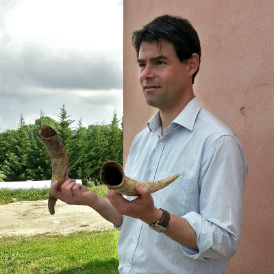 Cédric Lecareaux shows cow horns from Domaine Cigalus in Languedoc-Roussillon
