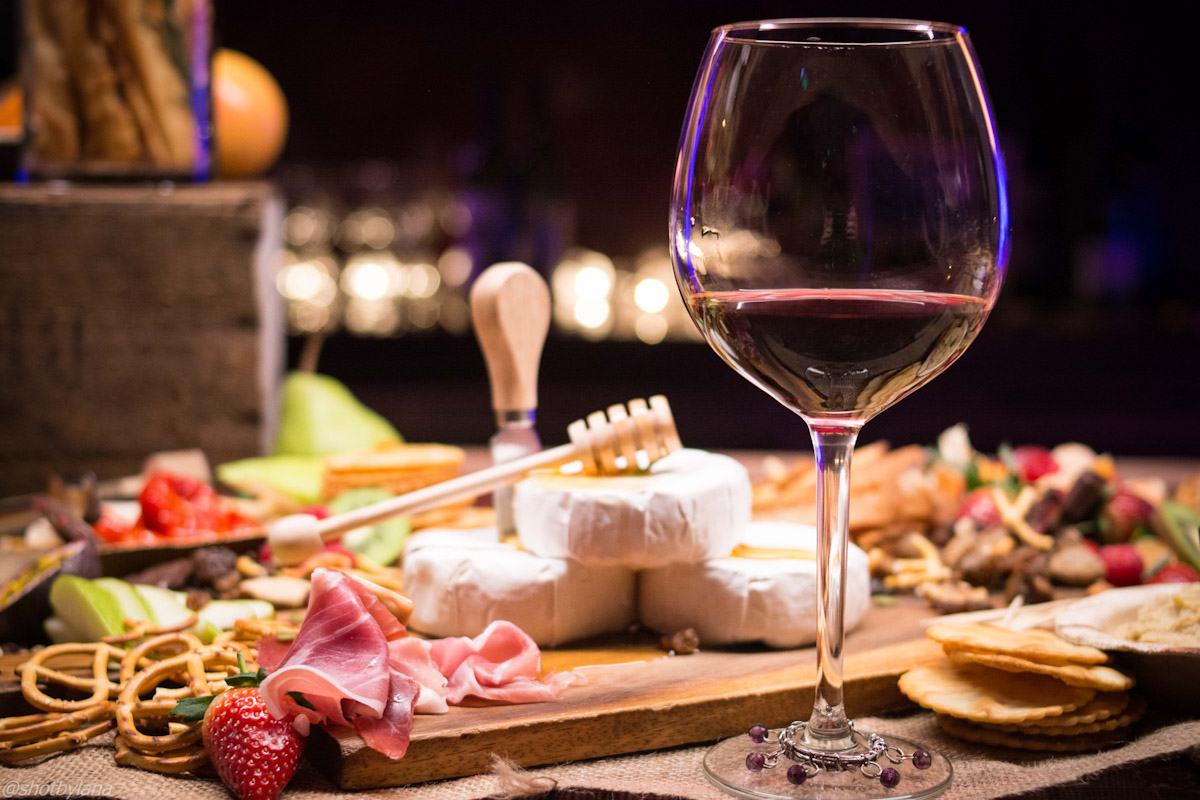 A wine dinner with cheese, meat, and honey. Photo by Lana Abie.