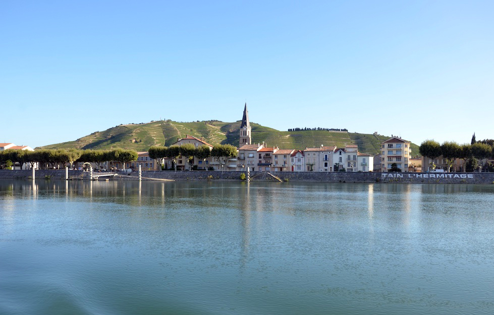 A view from the Rhone river looking up towards Tain l'Hermitage and Hermitage hill