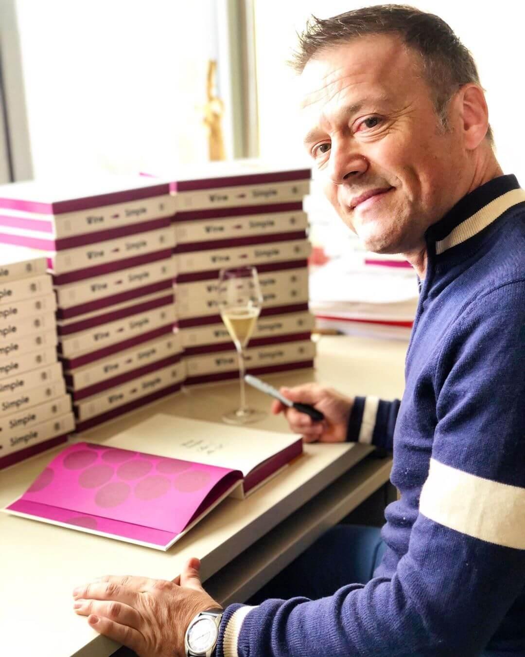 Aldo Sohm signing copies of his book Wine Simple.