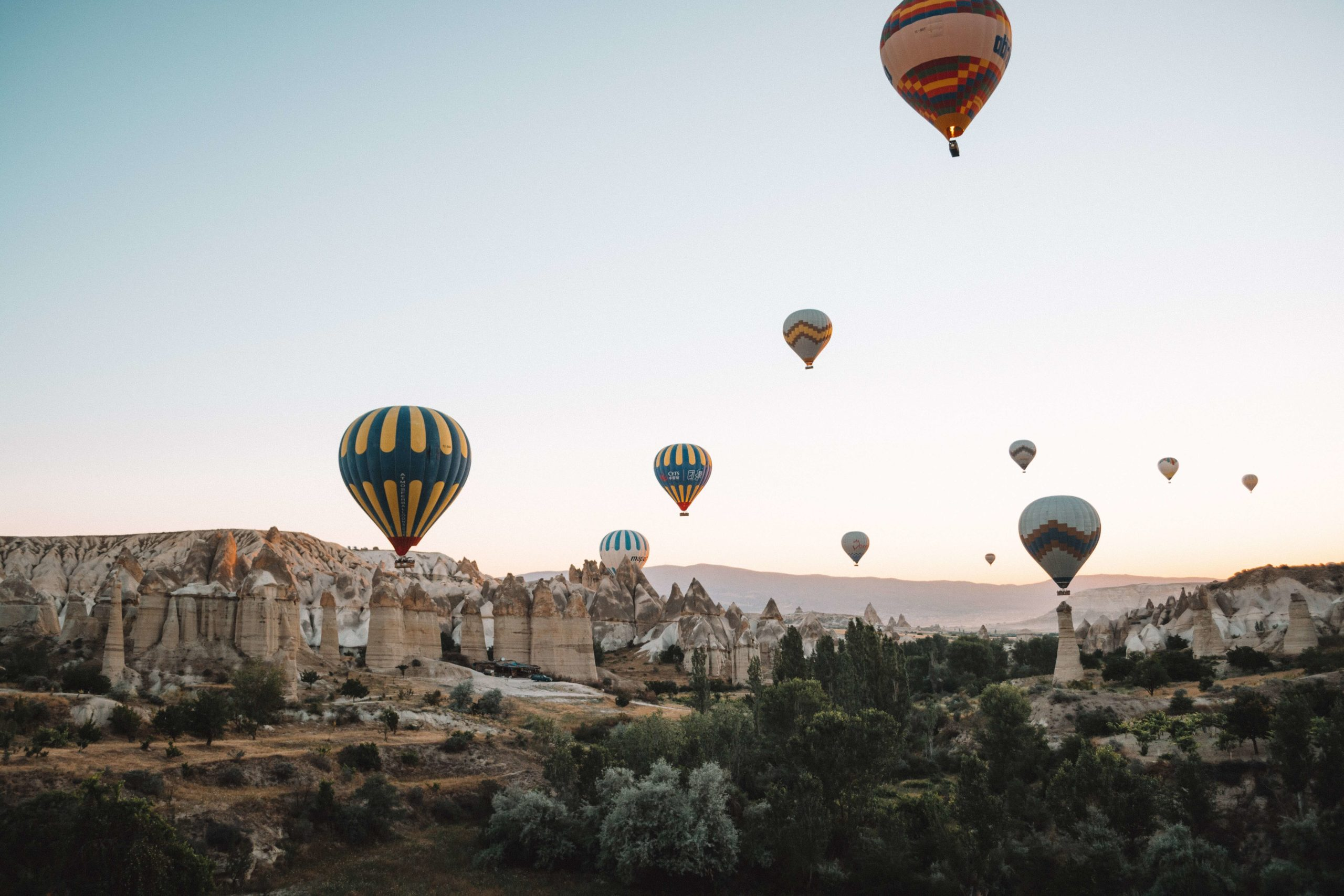 Hot air balloons high over Cappadocia, Turkey.