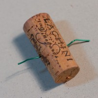 Wine cork with a wire through it