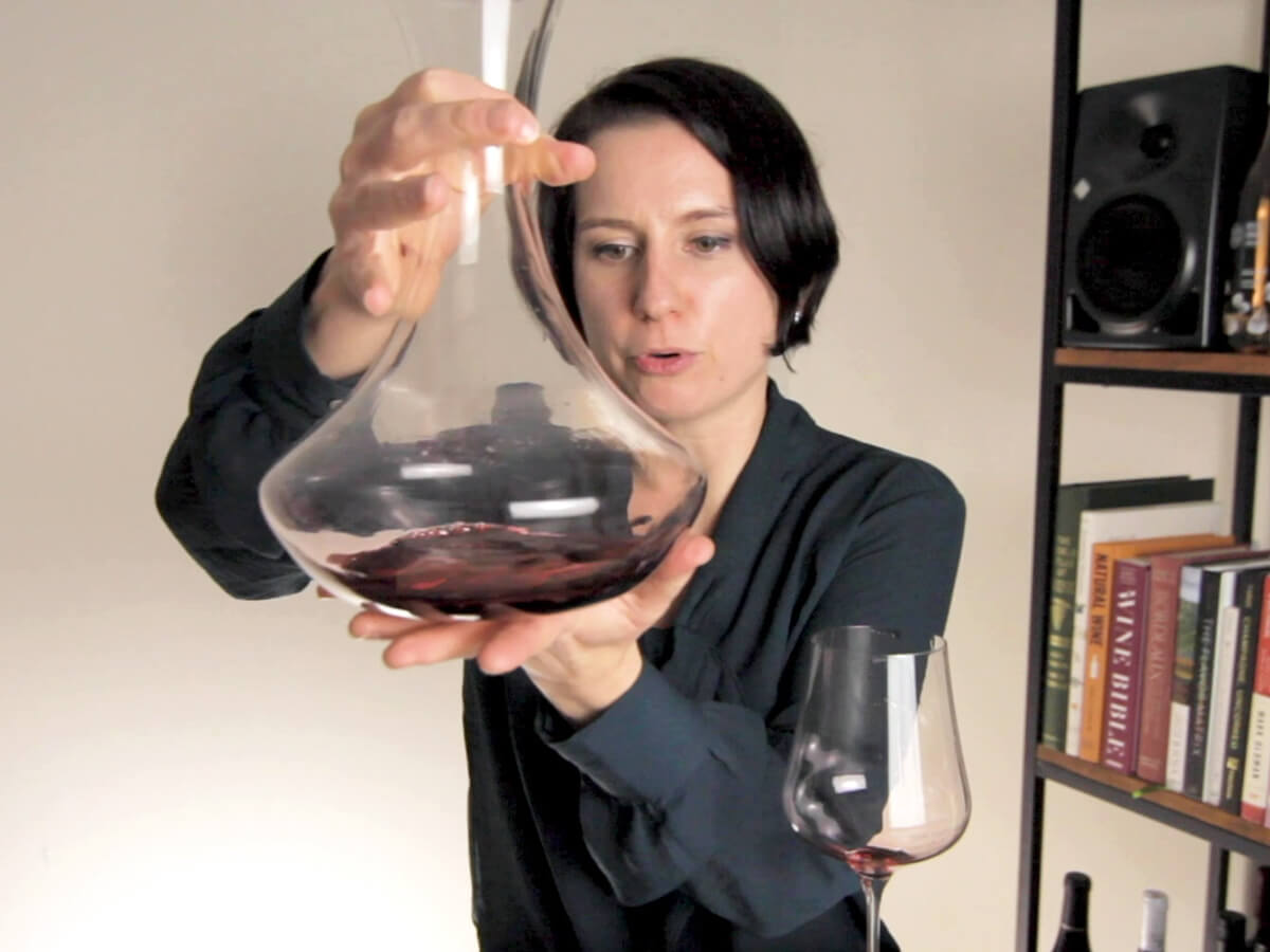 Madeline using a decanter on a bottle of Cabernet Sauvignon red wine