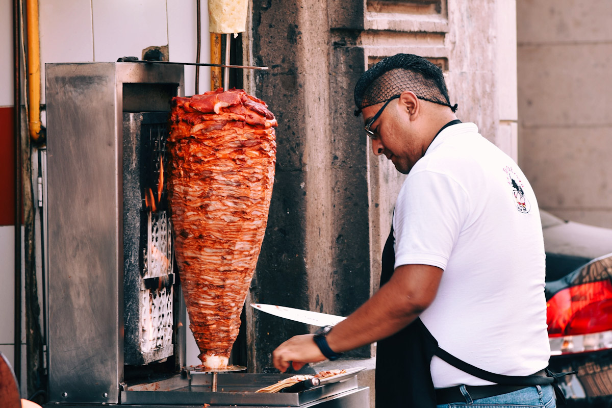 A man working a gyro machine.