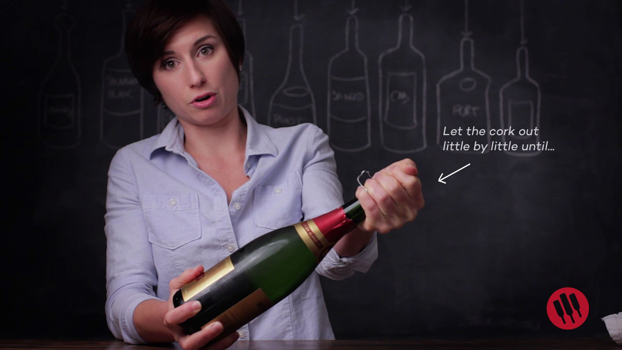 how to release a cork from champagne safely