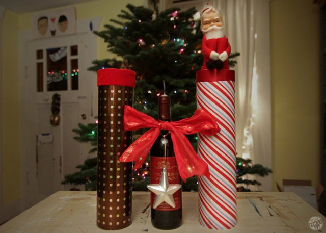 mailing tube and wrapping paper to wrap a wine bottle for Christmas