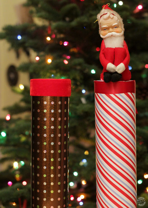 bottle of wine wrapped in a mailing tube as a christmas gift