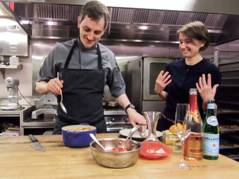 Joe Richie shows Madeline Puckette how to make bread pudding