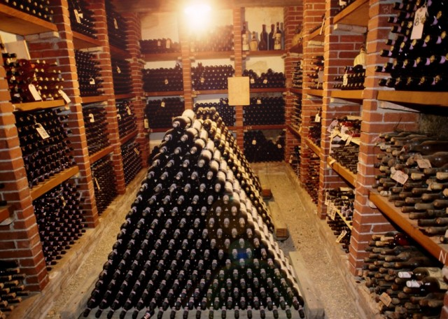 wine cellar with bins and a pyramid of wine