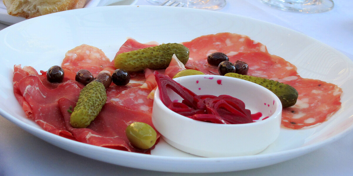 Olives and pickled veggies with cured meat.