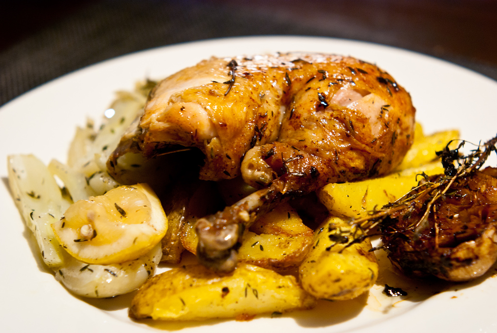 Roasted guinea fowl with garlic, lemon, fennel and potatoes.