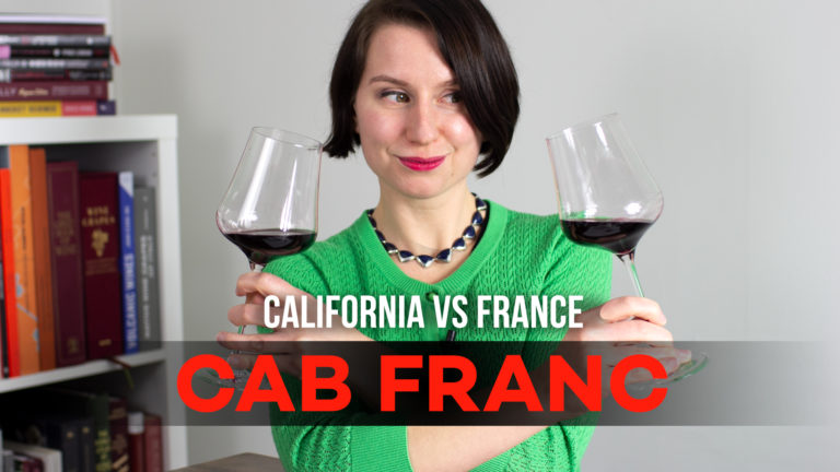 Madeline with two glasses of Cabernet Franc