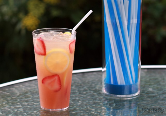 basic and strawberry wine cocktail with a bendy straw