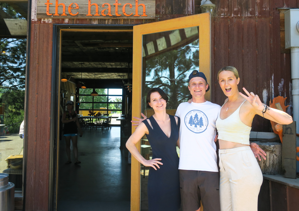 Laura, Johnny and Madeline Puckette pose outside of The Hatch, a negotiant-style winery in East Kelowna, BC By Wine Folly