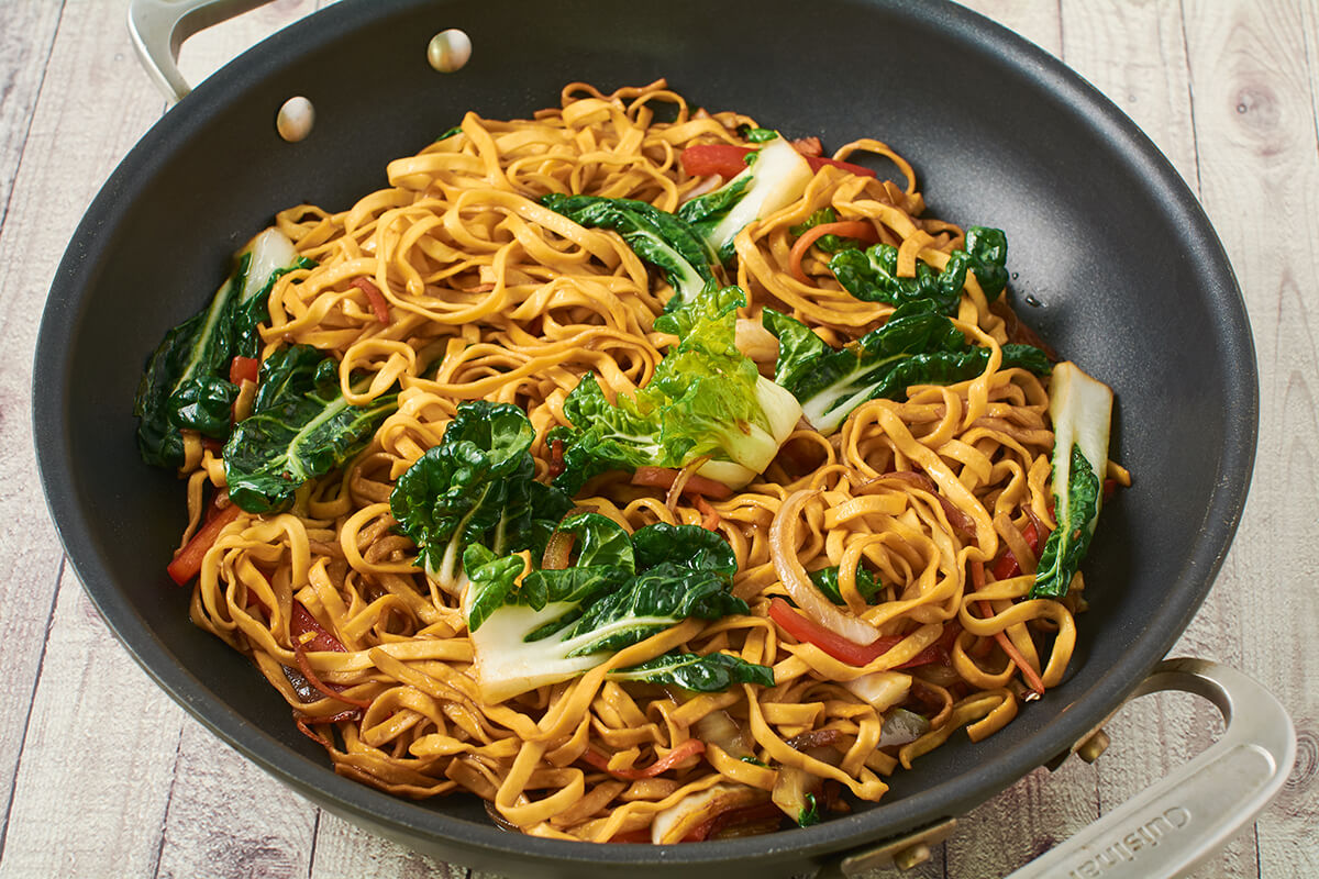 Vegetable Chow Mein in a wok.