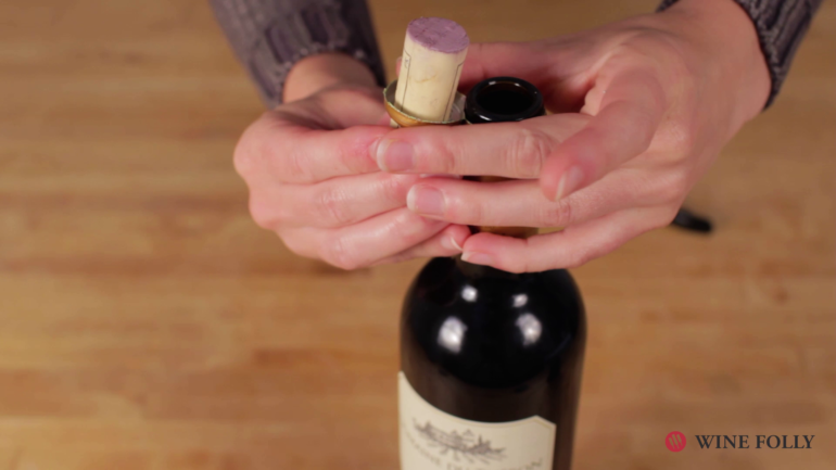 Put the cork in the loop of the foil - wine cork trick