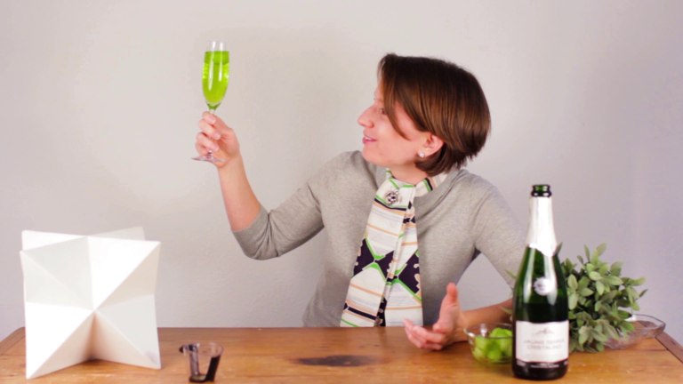 Madeline Puckette makes green wine cocktails for St. Pattys Day