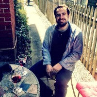 wine on the patio outside on a sunny day by Flickr user