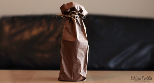 Wine Bottle in a paper bag tied with string for a blind tasting