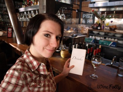 Madeline Puckette with a Wine List