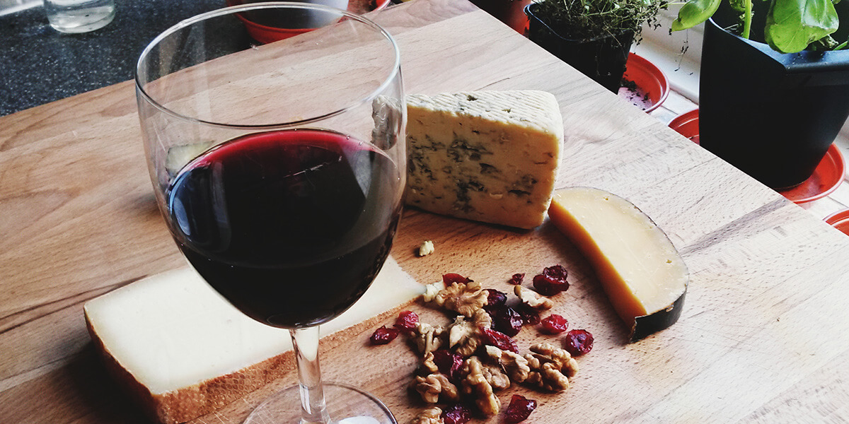 Red wine with cheese and nuts.